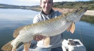Lure fishing by boat in Lozere
