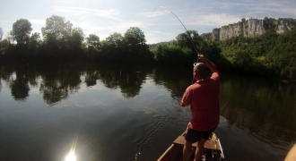 Fly fishing and trout by boat on the Dordogne river